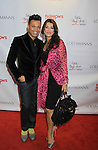 Felix Mercado & Lisa Vanderpump wearing Valentino - Celebrity Fashion Stylist Felix Mercado's Fashion Nght Out Runway Show and After Party was held on September 6, 2012 at Loehmann's, New York City, New York  Lisa Vanderpump (The Real Housewives of Beverly Hills) (Photo by Sue Coflin/Max Photos)
