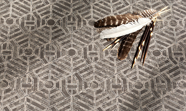 Concentrico, a waterjet and hand-cut stone stone, shown in honed and tumbled Cavern, is part of the Miraflores Collection by Paul Schatz for New Ravenna.