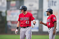 Billings Mustangs right fielder Bren Spillane (43) is congratulated by Satchel McElroy (14) after getting a hit during a Pioneer League game against the Ogden Raptors at Lindquist Field on August 17, 2018 in Ogden, Utah. The Billings Mustangs defeated the Ogden Raptors by a score of 6-3. (Zachary Lucy/Four Seam Images)