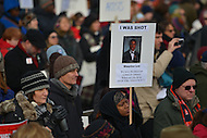 January 26, 2013  (Washington, DC)  A woman holds a sign remembering a victim of gun violence during a rally supporting gun control on the National Mall in Washington, D.C.  (Photo by Don Baxter/Media Images International)