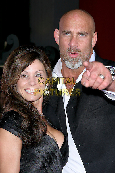 "BILL GOLDBERG & WIFE.World Premiere of ""The Longest Yard"" held at Grauman's Chinese Theatre..May 19th, 2005.Photo Credit: Jacqui Wong/AdMedia.headshot portrait pointing gesture goatee facial hair.www.capitalpictures.com.sales@capitalpictures.com.© Capital Pictures."