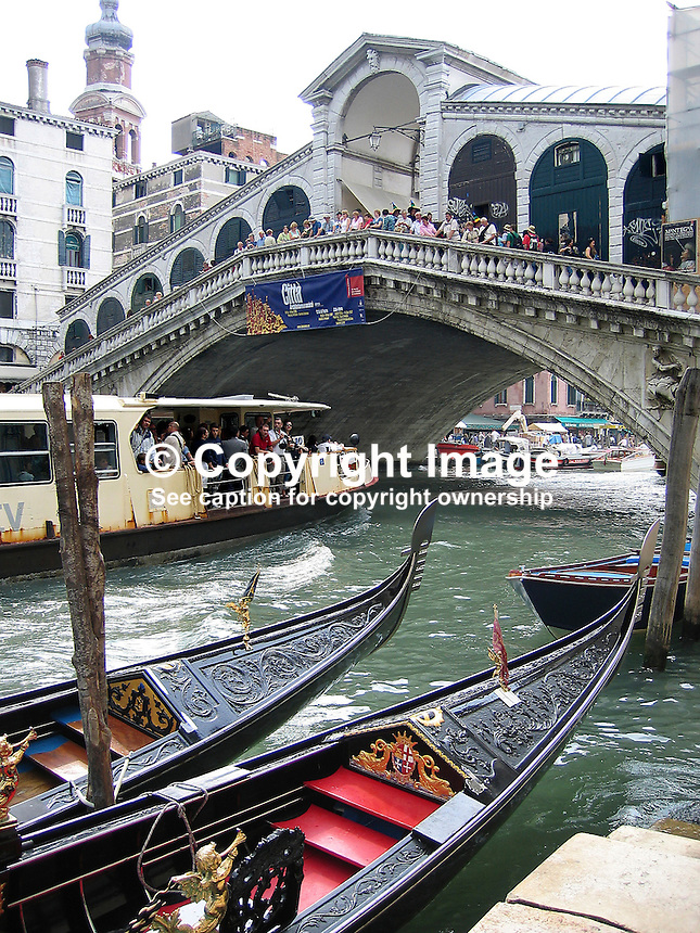 Vaporetto (water bus) passes under Rialto Bridge, Venice, Italy, gondolas in foreground, 200609140261..Copyright Image from Victor Patterson, 54 Dorchester Park, Belfast, UK, BT9 6RJ..Tel: +44 28 9066 1296.Mob: +44 7802 353836.Voicemail +44 20 8816 7153.Skype: victorpattersonbelfast.Email: victorpatterson@mac.com.Email: victorpatterson@ireland.com (back-up)..IMPORTANT: If you wish to use this image or any other of my images please go to www.victorpatterson.com and click on the Terms & Conditions. Then contact me by email or phone with the reference number(s) of the image(s) concerned.