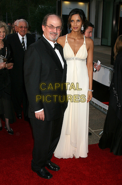 "SALMAN RUSHDIE & PADMA LAKSHMI .Arrive  to the opening of the 2006-07 season of the Metropolitan Opera at Lincoln Center with the new production of Puccini's ""Madame Butterfly"" directed by Academy Award winning director Anthony Minghella, New York, NY, USA..September 25th, 2006.Ref: IW.full length tuxedo white dress couple.www.capitalpictures.com.sales@capitalpictures.com.©Ian Wilson/Capital Pictures"
