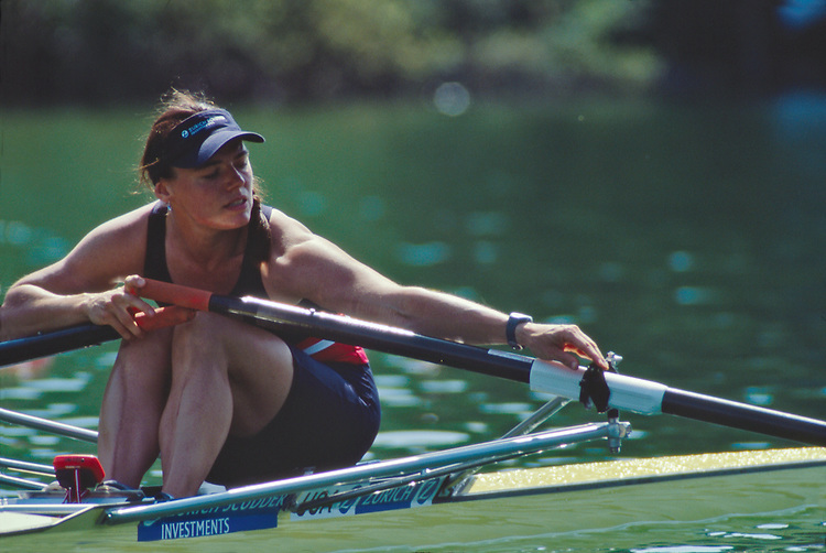 "Olympic and US National Rowing team rower Jennifer Devine rowing a single scull racing shell, checking her ""gate"", making sure her oar is securely in it's oarlock, Lucerne, Switzerland, FISA World Rowing Championships, Lucerne Rotsee,  2001, released,."