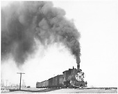 3/4 engineer's-side view of D&amp;RGW #318 with a 9-car freight under way between Montrose and Ridgway.<br /> D&amp;RGW  between Ridgway and Montrose, CO  Taken by Vollrath, Harold K. - 3/1950