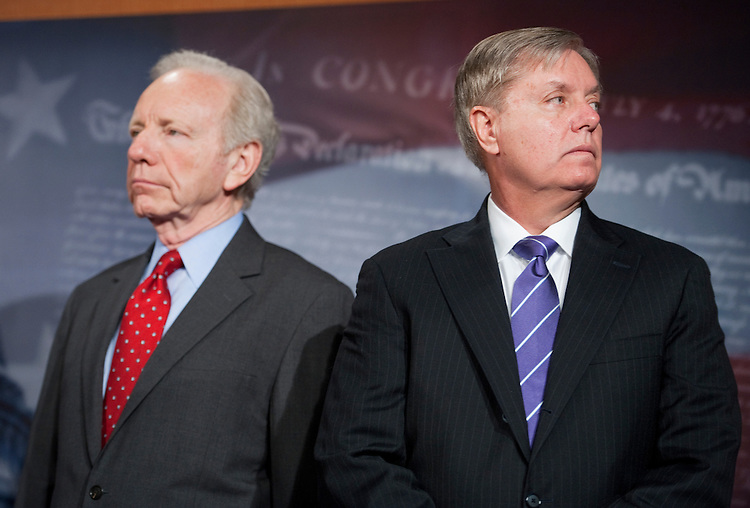 UNITED STATES - FEBRUARY 29:  Sens. Joe Lieberman, I-Conn., left, and Lindsey Graham, R-S.C., conduct a news conference to introduce a bipartisan resolution calling on Iran to respect human rights and hold free and open elections.  (Photo By Tom Williams/CQ Roll Call)