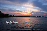 The sun sets over Pomham Rocks Lighthouse