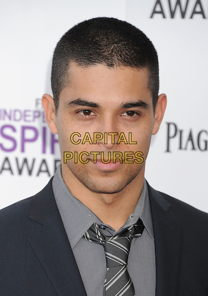 Wilmer Valderrama.The 2012 Film Independent Spirit Awards at Santa Monica Pier in Santa Monica, California, USA..February 25, 2012.headshot portrait shirt tie grey gray  .CAP/ROT/TM.©Tony Michaels/Roth Stock/Capital Pictures
