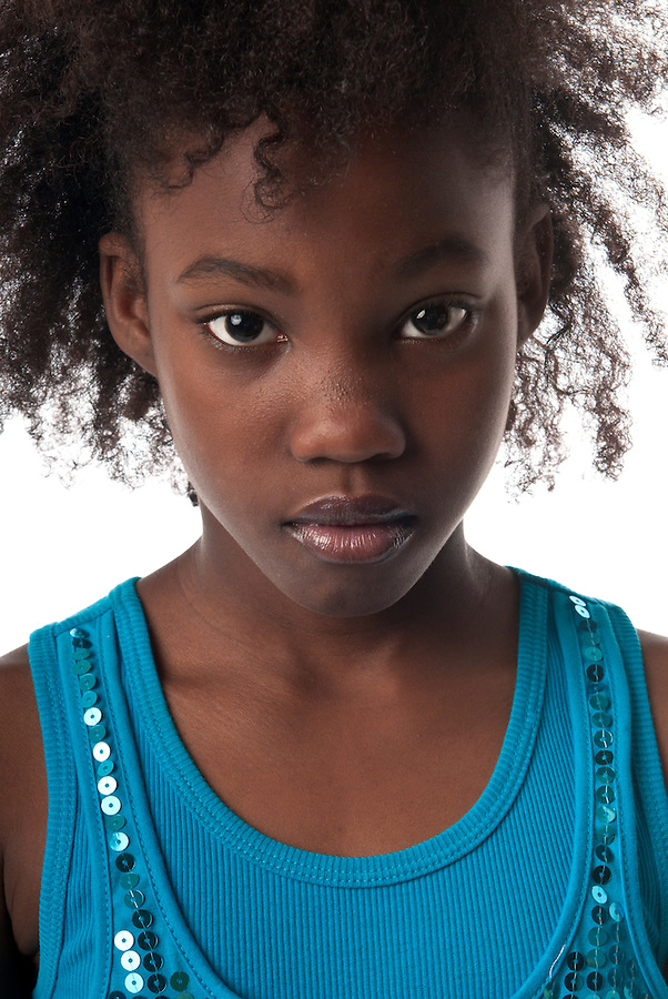 African American girl looking very serious at camera.