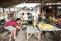 Photographer taking a photo of Krupuk (Kroepoek) production, Bukittinggi, West Sumatra, Indonesia