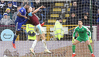 Leicester City's Wes Morgan scores his side's second goal past Thomas Heaton despite the attentions of James Tarkowski<br /> <br /> Photographer Rich Linley/CameraSport<br /> <br /> The Premier League - Burnley v Leicester City - Saturday 16th March 2019 - Turf Moor - Burnley<br /> <br /> World Copyright © 2019 CameraSport. All rights reserved. 43 Linden Ave. Countesthorpe. Leicester. England. LE8 5PG - Tel: +44 (0) 116 277 4147 - admin@camerasport.com - www.camerasport.com