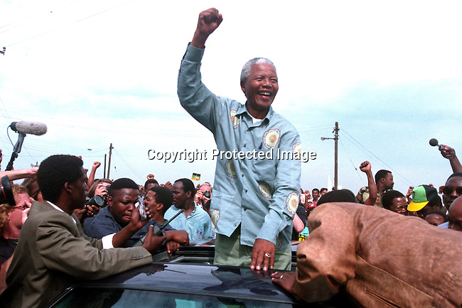 dipeman00555 .Personality. Nelson Mandela, the former president of South Africa on April 21, 1994 at a pre-election rally in Durban days before the historic democratic election on April 27, 1994 in South Africa. Mr Mandela became the first black democratic elected president in South Africa. He retired from office after one term in June 1999. .©Per-Anders Pettersson/ iAfrika Photos.