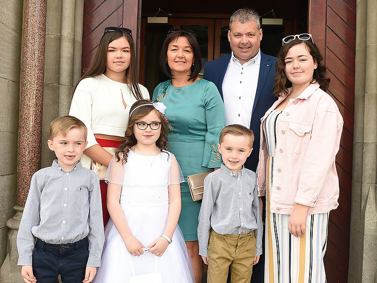 Isobel Wright from St. Mary's school who received First Holy Communion in St. Mary's church pictured with her family.  Photo:Colin Bell/pressphotos.ie
