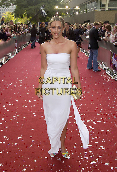 "MICHELLE HEATON.ITV's ""The Celebrity Awards"".London 26 September 2004.full length, white strapless dress, gold clutch purse.www.capitalpictures.com.sales@capitalpictures.com.©Capital Pictures"