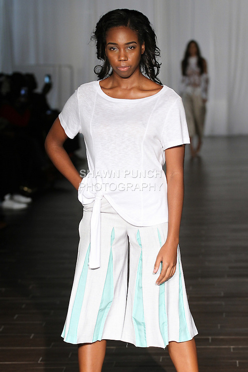 Model walks runway in an outfit from the SAKU Spring Summer 2017 by Lissa Koo for Fashion Week Brooklyn Spring Summer 2017, on October 8th 2016 at Brooklyn Expo Center.