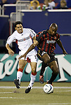 2 October 2004: Christian Gomez (left) and Eddie Pope (right) challenge for the ball in the first half. DC United defeated the MetroStars 1-0 at Giants Stadium in East Rutherford, NJ during a regular season Major League Soccer game..