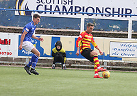 Scott McDonald shielding the ball from Barry Maguire in the SPFL Ladbrokes Championship football match between Queen of the South and Partick Thistle at Palmerston Park, Dumfries on  4.5.19.