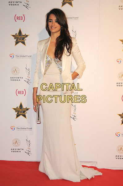 PENELOPE CRUZ.The Akvinta Presents A Night of Hollywood Domino Party at The House at Cannes during the 62nd International Cannes Film Festival, Cannes, France..May 18th, 2009 .full length white cream long maxi dress jacket hand on hip clutch bag silver .CAP/CAS.©Bob Cass/Capital Pictures.