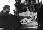 Rev. Ralph Abernathy scatters flowers over the casket of Martin Luther King Jr during burial rites at cemetery in Atlanta Georgia on April 9, 1968. (Photo copyright Jim Peppler 1968). This and over 10,000 other images are part of the Jim Peppler Collection at The Alabama Department of Archives and History:  http://digital.archives.alabama.gov/cdm4/peppler.php
