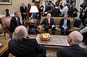 U.S. President Barack Obama, left, speaks as he meets with the 2016 American Nobel Prize laureates including Oliver Hart, professor at Harvard University and winner of the 2016 Sveriges Riksbank Prize in economic sciences in memory of Alfred Nobel, bottom right, F. Duncan Haldane, professor at Princeton University and laureate of the 2016 Nobel Prize in physics, bottom left, J. Fraser Stoddart, professor at Northwestern University and laureate of the 2016 Nobel Prize in chemistry, center, and J. Michael Kosterlitz, professor at Brown University and laureate of the 2016 Nobel Prize in physics, right, in the Oval Office of the White House in Washington, D.C., U.S., on Wednesday, Nov. 30, 2016. Annual prizes for achievements in physics, chemistry, medicine, peace and literature were established in the will of Alfred Nobel, the Swedish inventor of dynamite, who died in 1896. <br /> Credit: Andrew Harrer / Pool via CNP