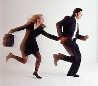 Man & woman couple holding hands running