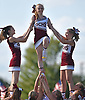 Garden City varsity cheerleaders, from left, Grace Chicco, Lisa Murphy and Amanda Galioto form a pyramid with help from their teammates providing base support during halftime of a Nassau County Conference II football game against Carey at Garden City High School on Saturday, Sept. 29, 2018.