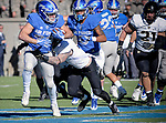 November 4, 2017:  Air Force running back, Tim McVey #33, works for extra yardage during the NCAA Football game between the Army West Point Black Knights and the Air Force Academy Falcons at Falcon Stadium, United States Air Force Academy, Colorado Springs, Colorado.  Army West Point defeats Air Force 21-0.