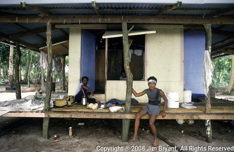 Caretakers rest on the wooden porch of their Neco Island home. the island republic of Palau has been everything from a Japanese military base to a U.S. Trust territory it now seeks profitable indignity as a plush Pacific resort..The Republic of Belau lies 1,300 kilometers, southwest of Guam, and 600 kilometers east of the Philippines. (Jim Bryant Photo).....