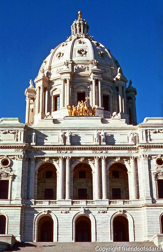 """St. Paul:  State Capitol 1893-1894--dome.  Capitol designed by Cass Gilbert.  Gold-leafed copper and steel quadriga  """"Progress of the State"""" by Sculptor Daniel Chester French and Edward Potter, 1905.  Photo '85."""