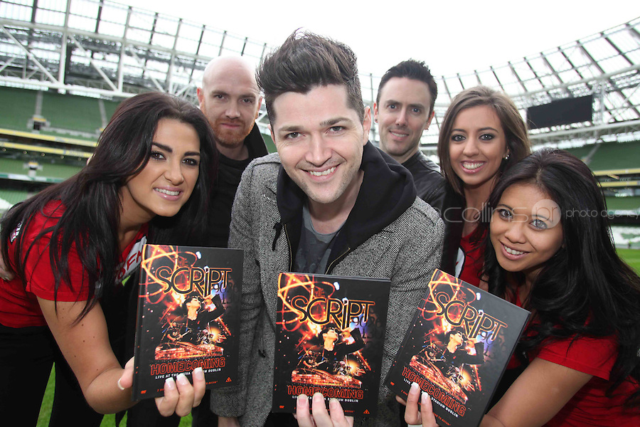 "NO REPRO FEE: 1.12.2011: Irish trio The Script pictured at the Aviva Stadium Dublin to mark the release of their first concert DVD ""HOMECOMING: LIVE AT THE AVIVIA STADIUM DUBLIN"" filmed by acclaimed director Dick Carruthers ( Oasis, White Stripes, Paul McCartney.) 98FM's Thunder Trio Jeri Mahon, Mary Scott and Angela Frawley joined band members Danny, Mark and Glen reliving the experience of playing on home turf to a 54,000 strong crowd! The Script were back in Dublin earlier this year on July 2nd  to play the sold-out show, the event that marked the pinnacle of the band's career to date coming just 3 years after their 1st gig at Dublin's Sugar Club in front of 28 people. The DVD is of the entire concert, includes their hits ""The Man Who Can't be Moved"", ""Nothing"" and ""Breakeven."" Pictured (l-r) at the DVD launch was 98FM's Thunder Trio Angela Frawley, Mary Scott and Jeri Mahon with Script band members Mark Sheehan, Danny O'Donoghue and Glen Power. Picture Collins."