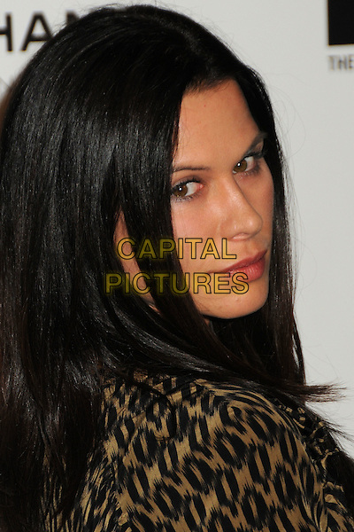 "RHONA MITRA .attending MOCA's Annual Gala, ""The Artist's Museum Happening"", Sponsored by Chanel Fine Jewelry, held at MOCA Grand Avenue (Museum Of Contemporary Art) in Los Angeles, California, USA, November 13th 2010. .portrait headshot side over shoulder profile gold khaki black print .CAP/ADM/BP.©Byron Purvis/AdMedia/Capital Pictures."