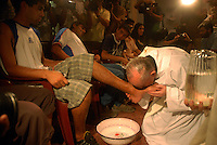 Newly elected Pope Jorge Bergoglio wash the feet of drug addicts in a rehabilitation center in a church facility in the south of Buenos Aires city, during Eastern 2008