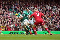 Pictured: Sean O'Brien of Ireland (L) about to be tackled by Lee Samson of Wales (R) Saturday 14 March 2015<br />