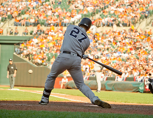 New York Yankees catcher Austin Romine (27) hits a sacrifice fly to center scoring second baseman Starlin Castro (14) and allowing third baseman Chase Headley (12) to score on an error in the ninth inning against the Baltimore Orioles at Oriole Park at Camden Yards in Baltimore, MD on Sunday, April 9, 2017.  The Yankees won the game 7 - 3. <br /> Credit: Ron Sachs / CNP<br /> (RESTRICTION: NO New York or New Jersey Newspapers or newspapers within a 75 mile radius of New York City)