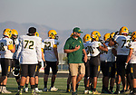 Manogue Coach Ernie Howren talks with his team before their game played at McQueen High School on Friday, September 1, 2017.