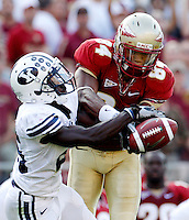 TALLAHASSEE, FL 9/18/10-FSU-BYU FB10 CH-Florida State's Rodney Smith and Brigham Young's Corby Eason battle for a pass during second half action Saturday at Doak Campbell Stadium in Tallahassee. The Seminoles beat the Cougars 34-10..COLIN HACKLEY PHOTO