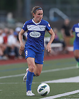 Boston Breakers midfielder Heather O'Reilly (9) on the attack.  In a National Women's Soccer League (NWSL) match, Boston Breakers (blue) defeated Sky Blue FC (white), 3-2, at Dilboy Stadium on June 30, 2013.