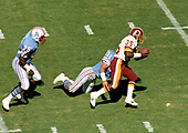 Washington Redskins running back Keith Griffin (38) carries the ball against the Houston Oilers at RFK Stadium in Washington, DC on September 16, 1985.   Defending on the play for Houston are:  defensive back Jeff Donaldson (31) and strong safety Keith Bostic (25).  The Redskins won the game 16 - 13.<br /> Credit: Howard L. Sachs / CNP