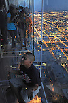 "Visitors on the newly opened glass balconies ""The Ledge"" at the Skydeck at the Sears Tower in Chicago on July 6, 2009."