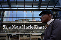 "NEW YORK, USA - October 14: A man walks along 8av as the New York Times building is seen at the background on October 14, 2019 in New York, USA. NY Times on Sunday evening, published a story titled, ""Macabre Video of Fake Trump Shooting Media and Critics Is Shown at His Resort."" The video showed the president as a mass shooter where he is executing media and his political opponents inside church. It was dysplayed at a pro Trump conference in Miami. NY Times is an American newspaper based in New York City with worldwide influence,  the paper has won 127 Pulitzer Prizes,  being ranked 18th in the world by circulation. (Photo by Eduardo MunozAlvarez/VIEWpress)"