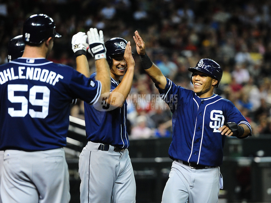 Jul. 3, 2012; Phoenix, AZ, USA: San Diego Padres second baseman Alexi Amarista (right) celebrates with teammates after scoring in the fourth inning against the Arizona Diamondbacks at Chase Field. Mandatory Credit: Mark J. Rebilas-