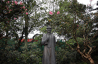 "A statue of a Taoist figure stands within the grounds of the Dujiangyan Irrigation System. The system is regarded as an ""ancient Chinese engineering marvel."" By naturally channeling water from the Min River during times of flood, the irrigation system served to protect the local area from flooding and provide water to the Chengdu basin. Sichuan Province. 2010"