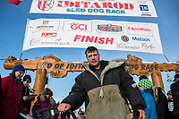 Ray Redington Jr. poses at his sled at the Nome finish line on Wednesday March 14th in the 46th running of the 2018 Iditarod Sled Dog Race.  <br /> <br /> Photo by Jeff Schultz/SchultzPhoto.com  (C) 2018  ALL RIGHTS RESERVED