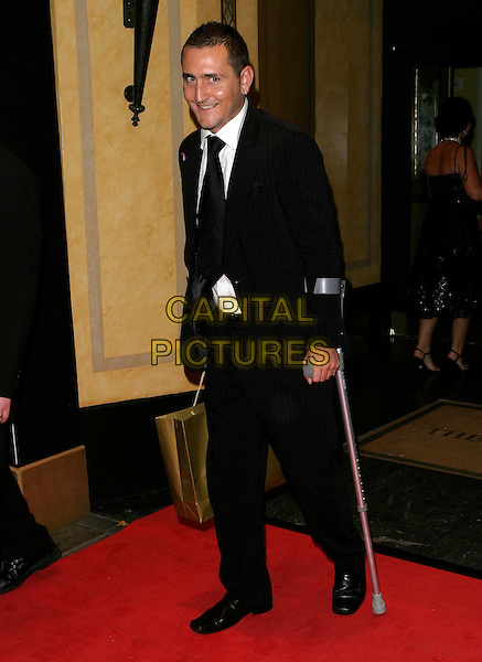 WILL MELLOR.Leaving the TV Quick & TV Choice Awards 2006,.The Dorchester Hotel, London, England,.September 4th 2006..full length on crutches injured leg walking stick.Ref: AH.www.capitalpictures.com.sales@capitalpictures.com.©Adam Houghton/Capital Pictures.