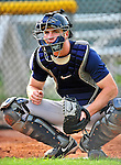 19 July 2010: Staten Island Yankees catcher Jeffrey Farnham warms up a pitcher prior to a game against the Vermont Lake Monsters at Centennial Field in Burlington, Vermont. The game was rained out. Mandatory Credit: Ed Wolfstein Photo