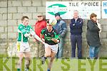 Paul Kennelly (Ballydonoghue) and Mark O'Connor (Churchill) wioth the ball..