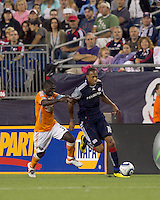 New England Revolution forward Khano Smith (18) moves down the wing as Houston Dynamo midfielder Anthony Obodai (35) pressures. The New England Revolution defeated Houston Dynamo, 1-0, at Gillette Stadium on August 14, 2010.