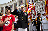 Craig Thomas (L) and United States Marine 2nd Lieutenant Adam Carroll stand during the playing of the national anthem during Memorial Day activities at Arlington National Cemetery in Washington on Monday, May 27, 2013. .Credit: Joshua Roberts / Pool via CNP
