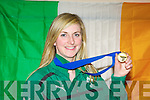 Irish Rugby heroine Siobhain Fleming displays her Six Nations Championship medal at Kerry Airport on Monday night
