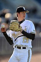 Vanderbilt Commodores pitcher Walker Buehler (13) throws in the outfield before a game against the Indiana State Sycamores on February 20, 2015 at Charlotte Sports Park in Port Charlotte, Florida.  Vanderbilt defeated Indiana State 3-2.  (Mike Janes/Four Seam Images)